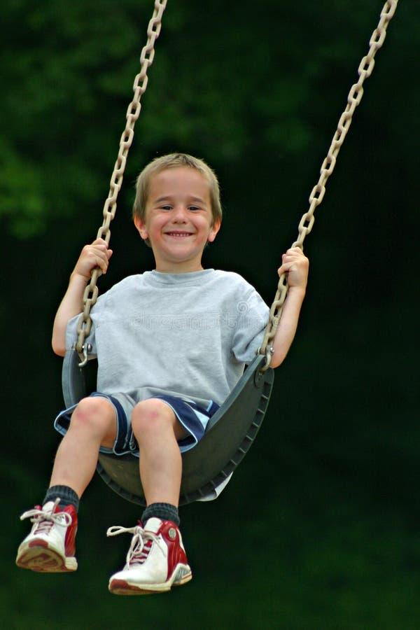 Boy Swinging stock image