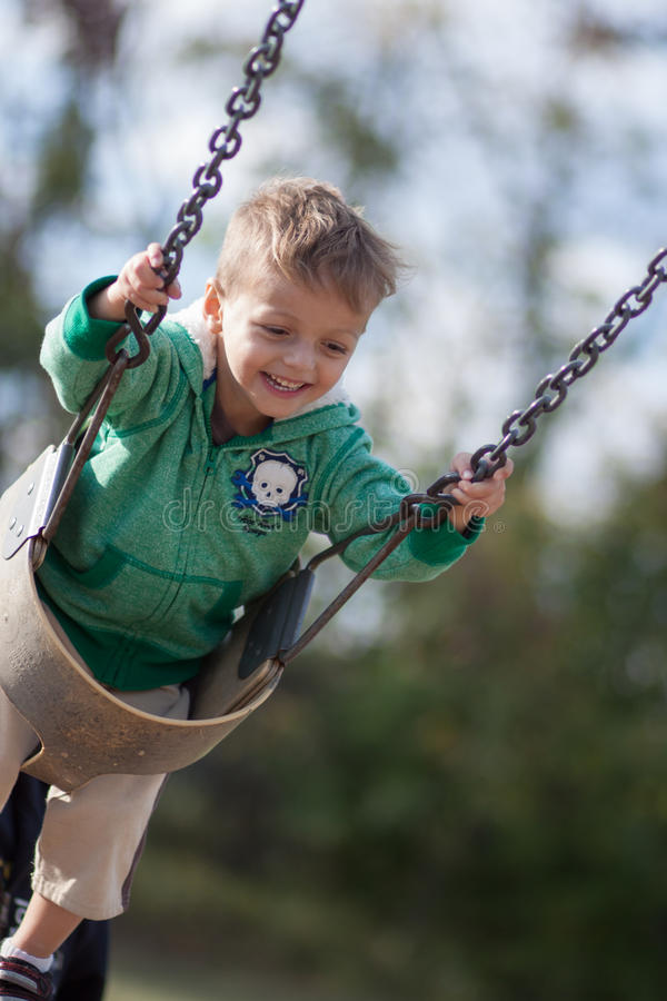 Download Boy swinging stock image. Image of smile, little, trees - 45540893