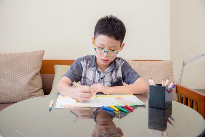 Download Boy At The Table Draw With Color Pencils Stock Photo - Image of happy, cute: 85588160