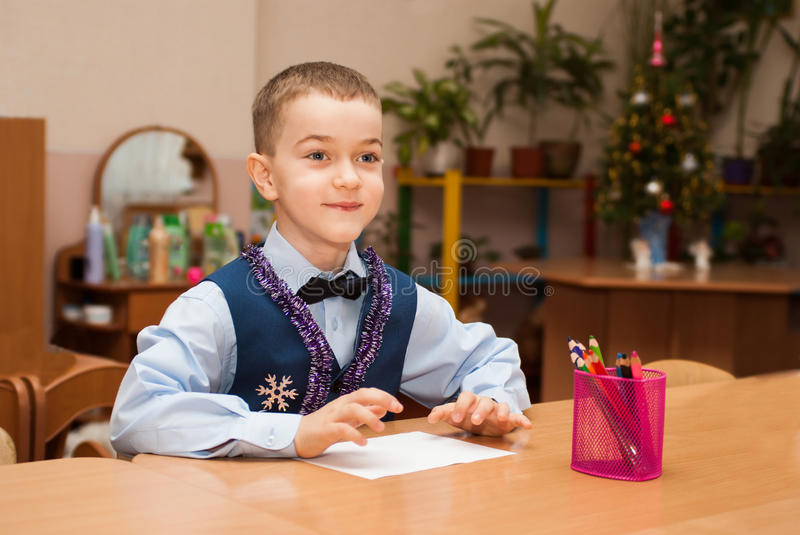 Boy at the table stock photos