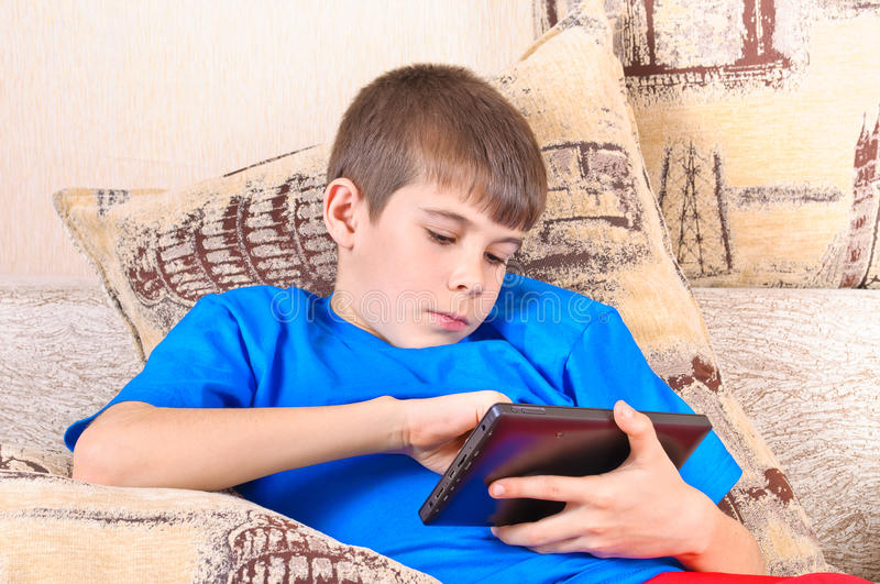 Boy with a Tablet PC royalty free stock photo