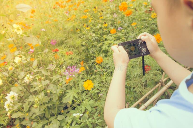 Boy take shot. Chinese boy take shot in garden royalty free stock photography