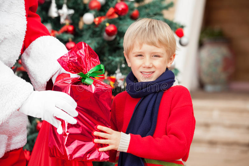 Download Boy Taking Gift From Santa Claus Stock Photo - Image: 36834926