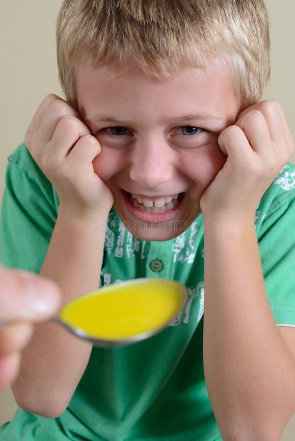 Boy Taking Medicine Stock Images
