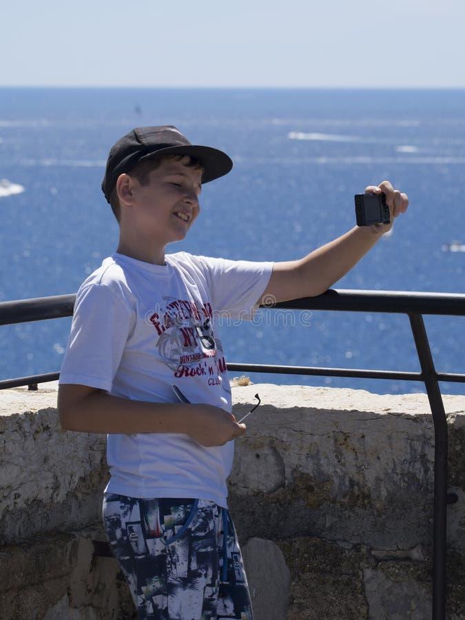 Boy taking selfie royalty free stock image