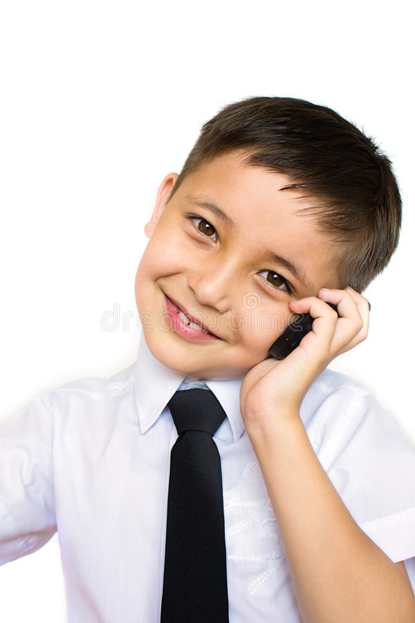 A Boy Talking On The Phone Stock Photos