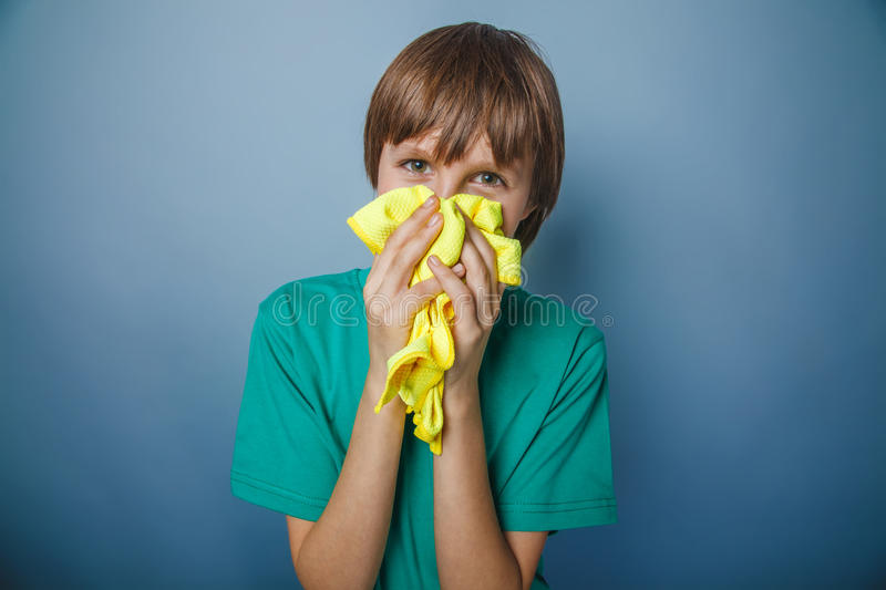 Boy teenager European appearance in a green T stock photo