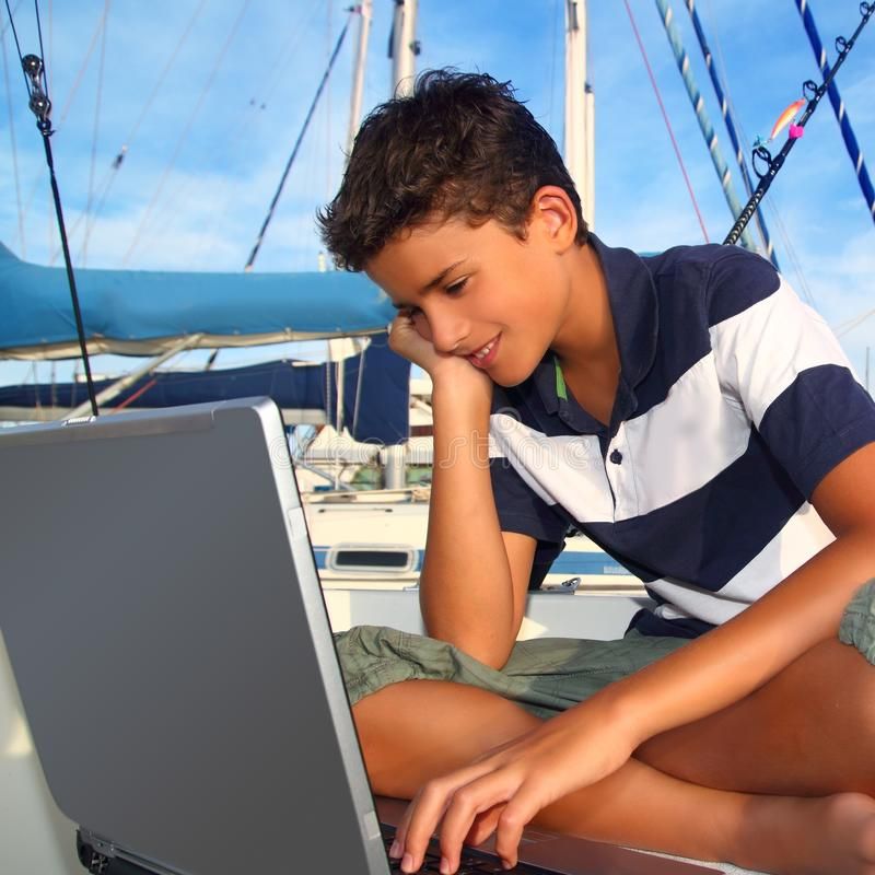 Free Boy Teenager Seat On Boat Marina Laptop Computer Royalty Free Stock Photos - 16700088
