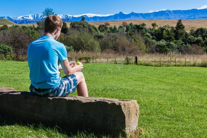 Download Boy Teenager Sitting Mountains Stock Photo - Image: 30596176