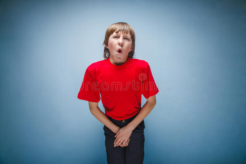 Boy, teenager, twelve years in the red shirt wants stock images