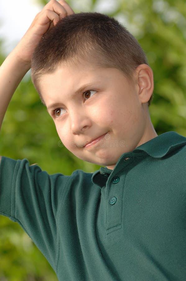 Boy thinking stock photos