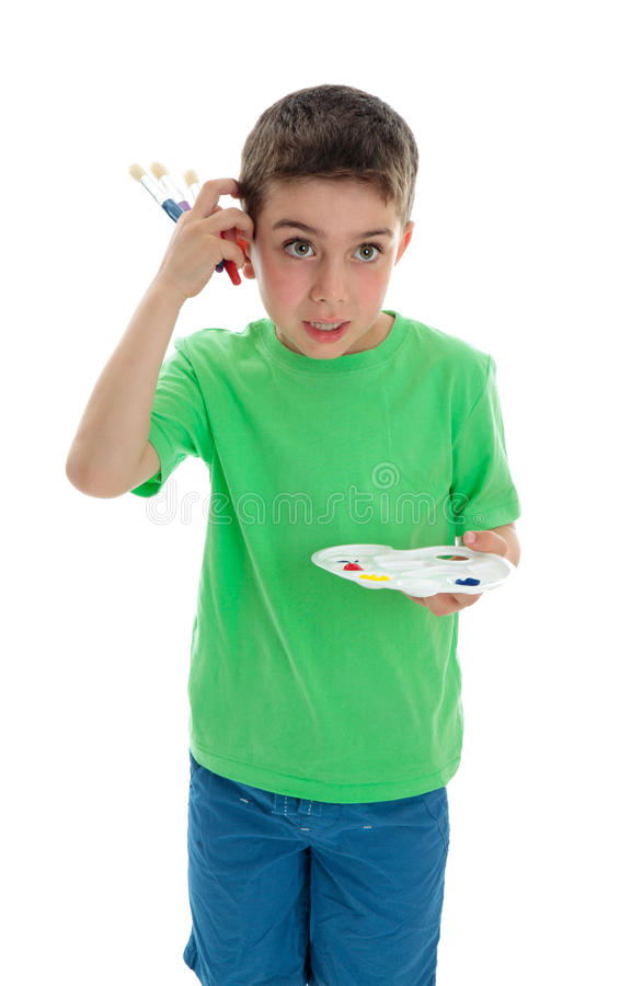 Boy thinking what to paint royalty free stock photography