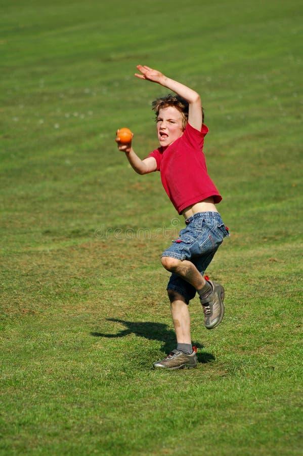 Boy throwing ball royalty free stock photos