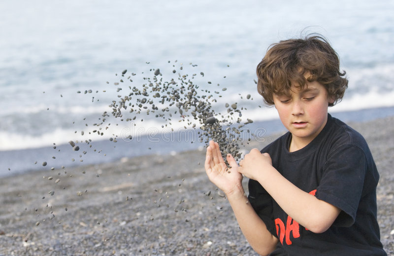 Download Boy Throwing Shingle On Beach Stock Image - Image: 1287181