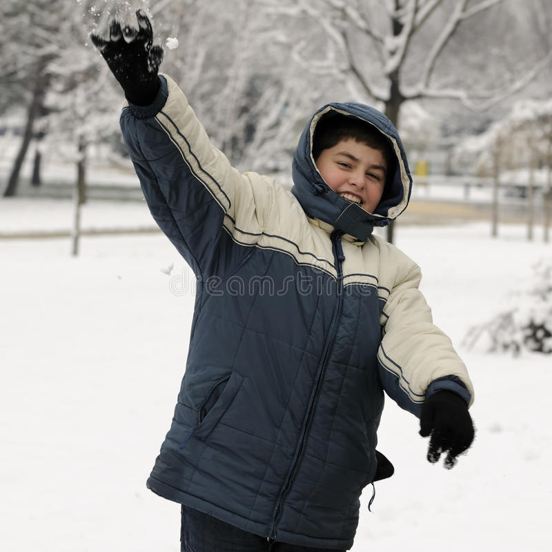 Download BOY THROWING A SNOWBALL stock image. Image of cheerful - 13148941