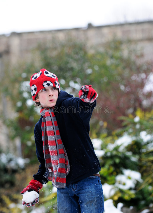 Download Boy throwing snowball stock photo. Image of white, childhood - 8149194