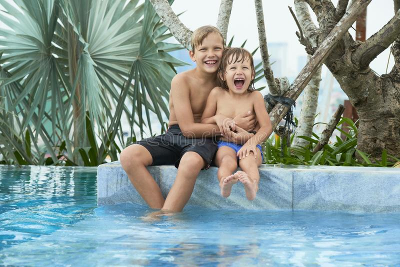 Boy tickling brother stock photo
