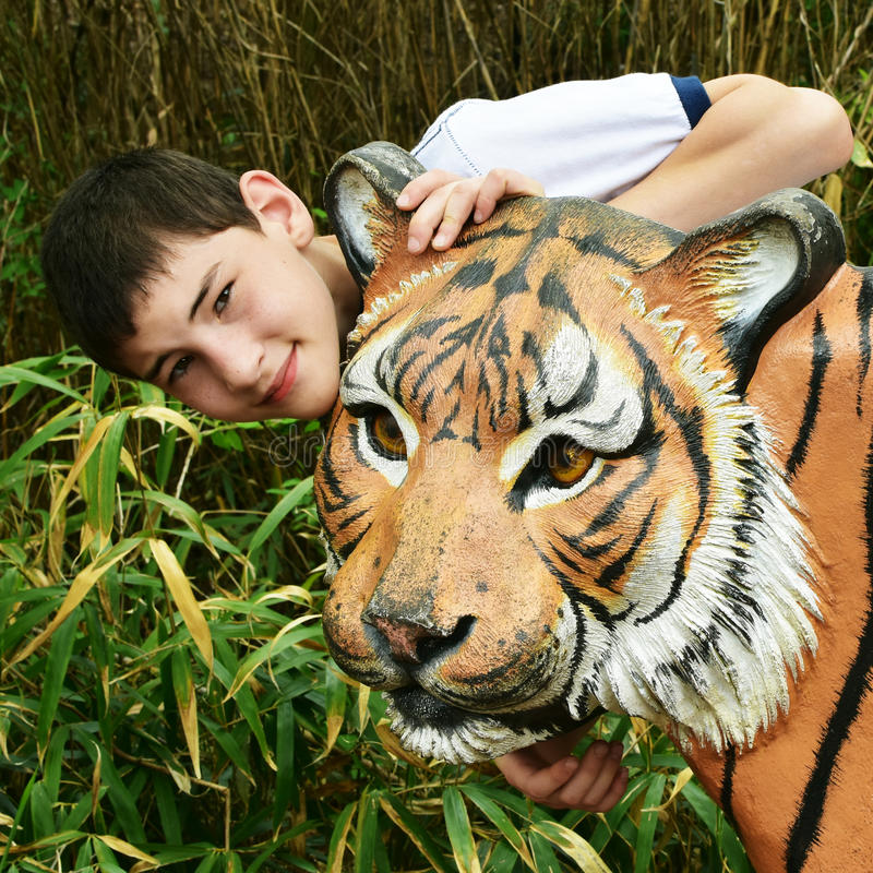 Boy with Tiger Statue stock photos