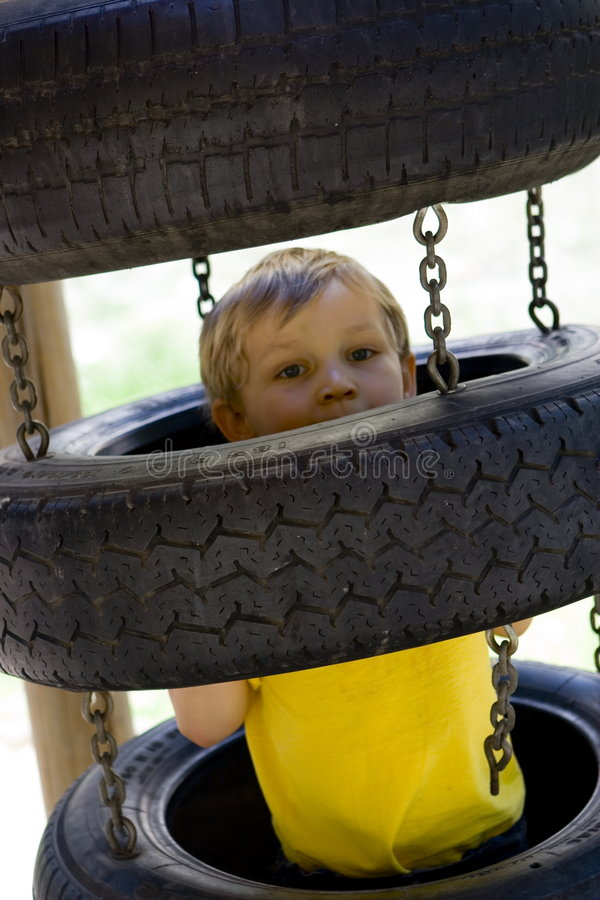 Boy in tires stock images