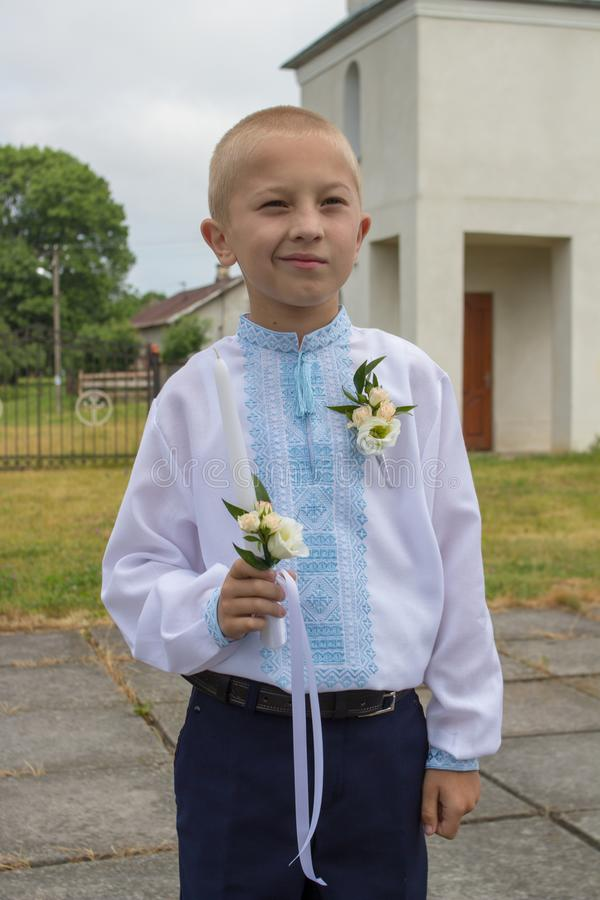 Boy to the first communion,A young boy celebrating his first holy communion. A young boy celebrating his first holy communion stock images