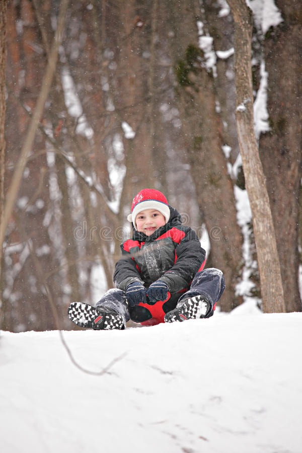 Download Boy On Tobbogan On Top Of Hill Stock Photo - Image: 22976186