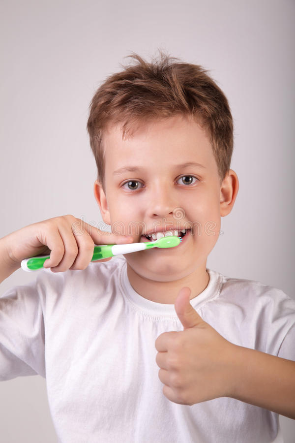 Boy With Tooth Brush Royalty Free Stock Photo