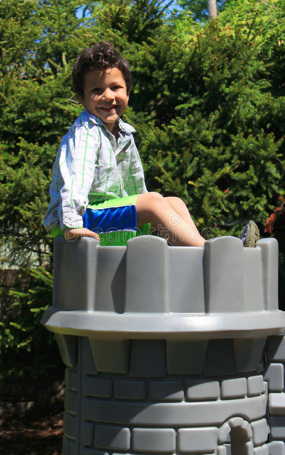 Boy On Top Of Castle Royalty Free Stock Photography