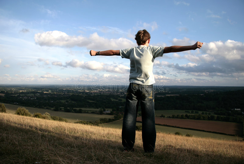 Download Boy on the top of hill stock photo. Image of teen, below - 1410778