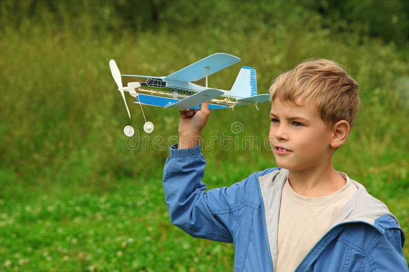 Download Boy With Toy Airplane In Hands Stock Photo - Image: 11411360