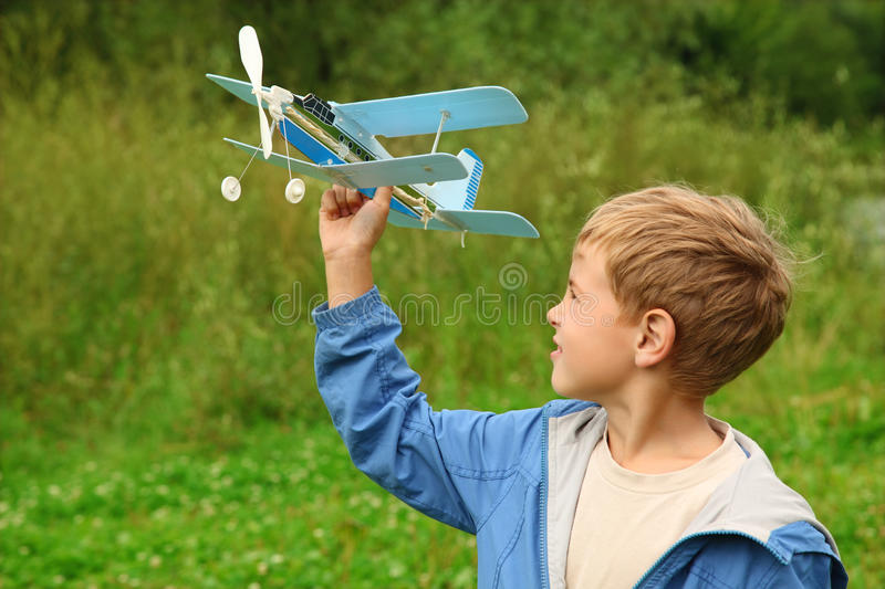 Download Boy With Toy Airplane In Hands Stock Image - Image of nature, model: 11411365