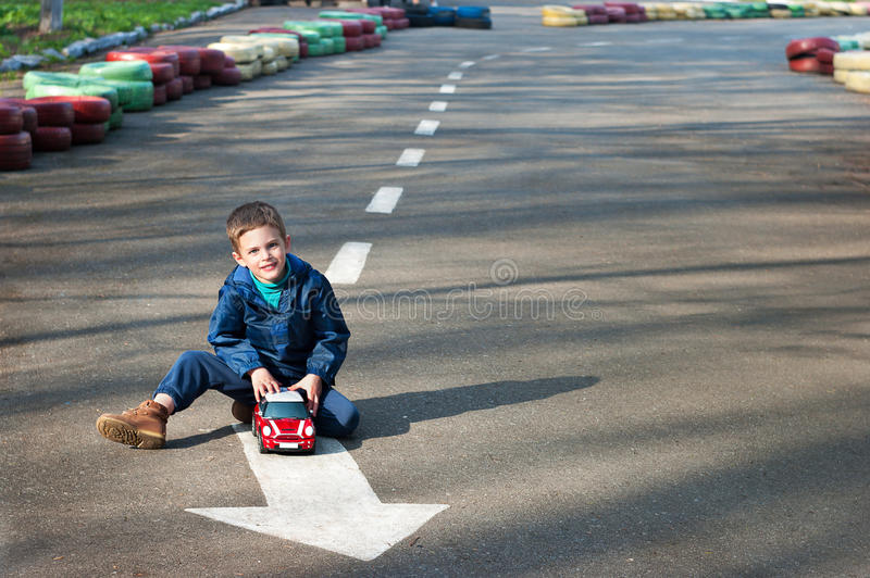 Boy with a toy car royalty free stock photo
