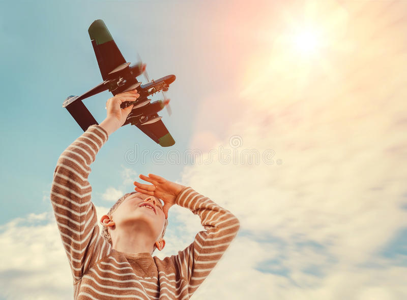 Boy with toy plane stock photography