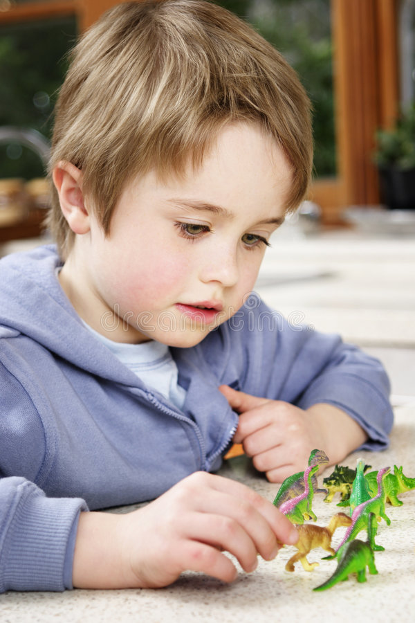 Boy with toys. Child playing with toys at home royalty free stock image