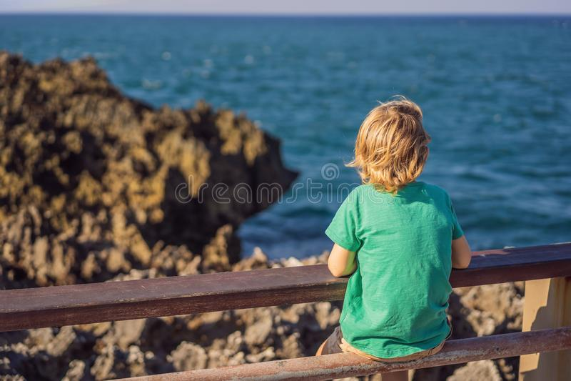 Boy traveler on amazing Nusadua, Waterbloom Fountain, Bali Island Indonesia. Traveling with kids concept.  royalty free stock images
