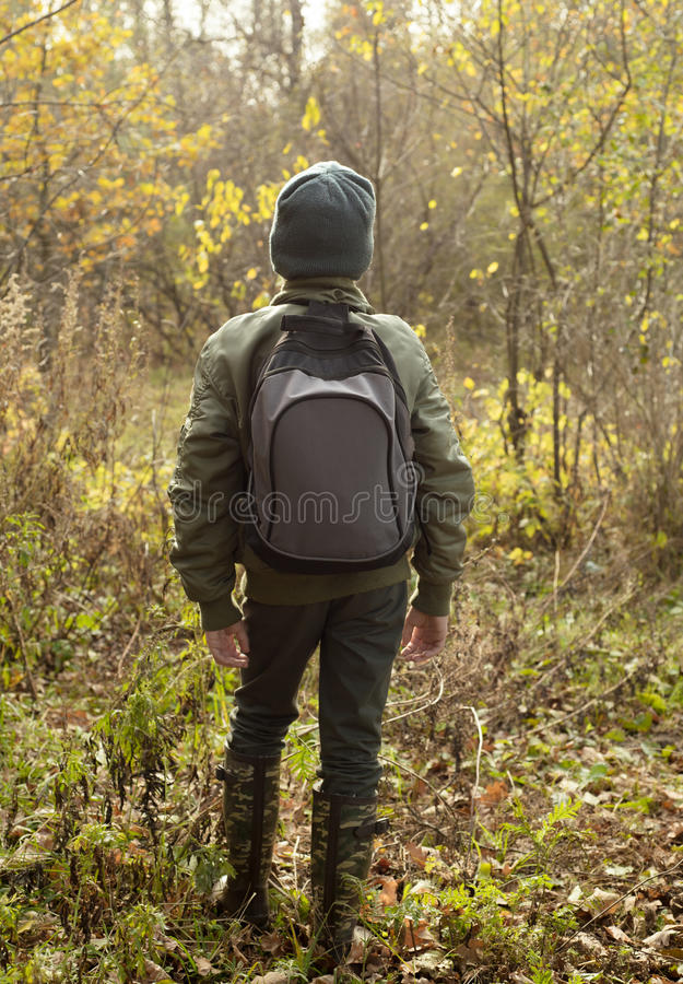 Boy-traveler with a backpack royalty free stock images