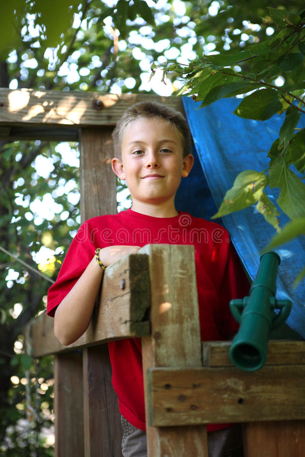 Boy in tree fort stock images