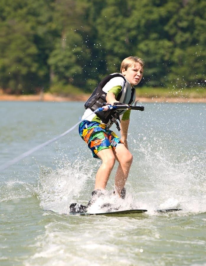 Boy On Trick Skis Turning Stock Photography