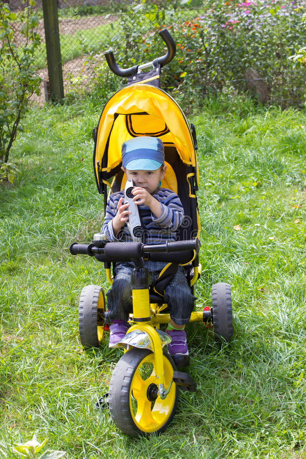 Boy Tricycles royalty free stock image