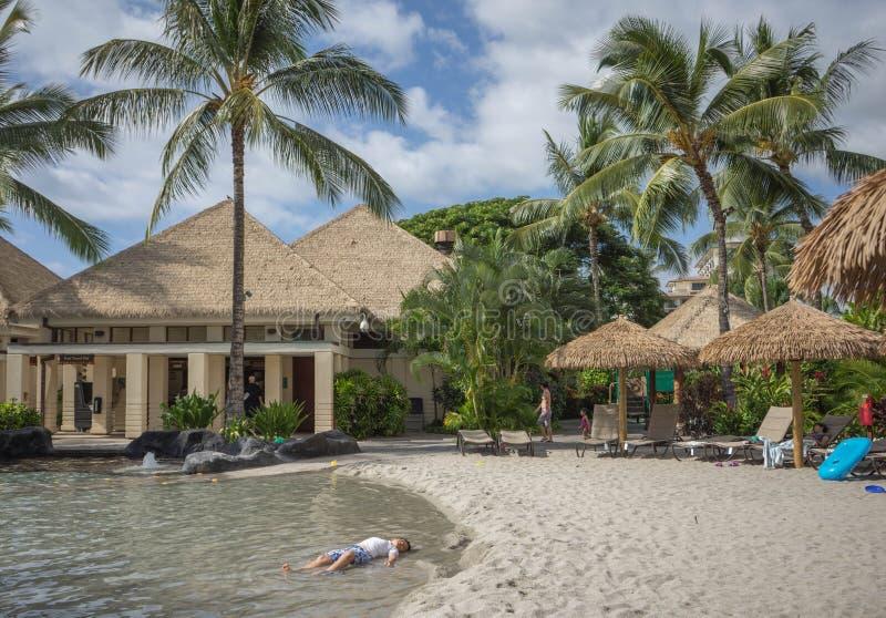 Boy on tropical beach stock photo