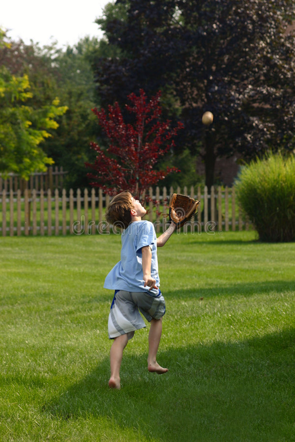 Download Boy Trying to Catch Ball stock photo. Image of playing - 1244542