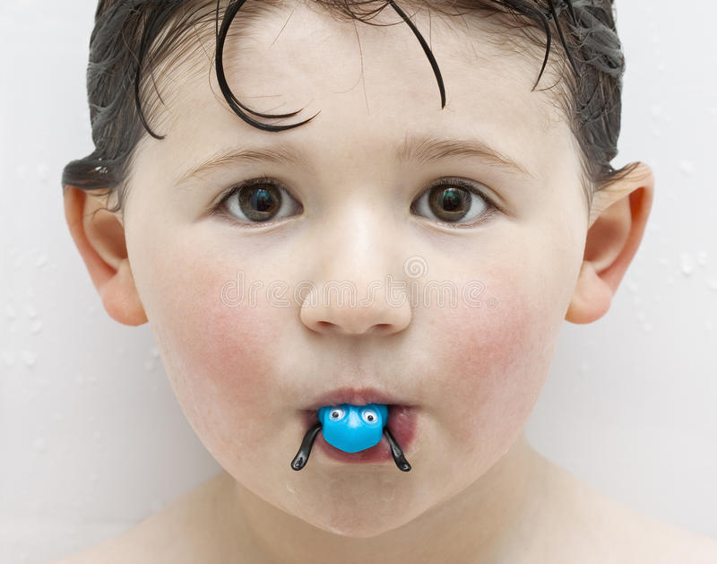 Boy in Tub Playing with Toy Frog stock photo