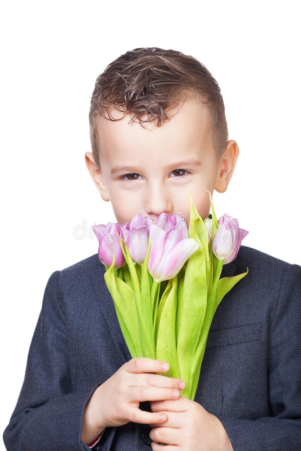Boy with tulips. On isolated white royalty free stock image