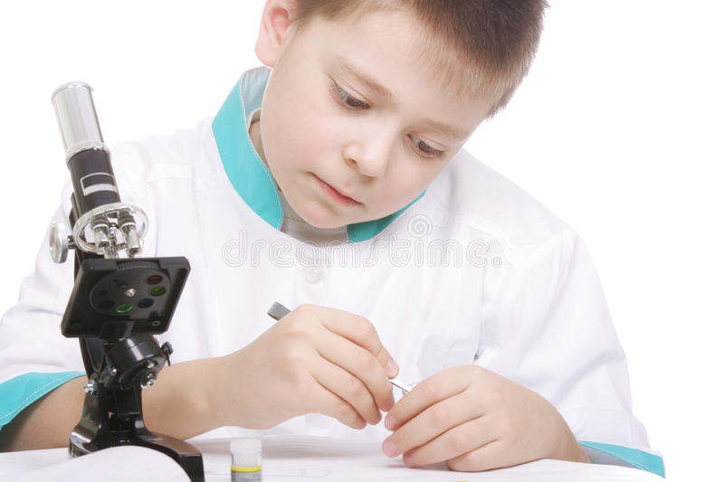 Boy with tweezers and microscope royalty free stock image