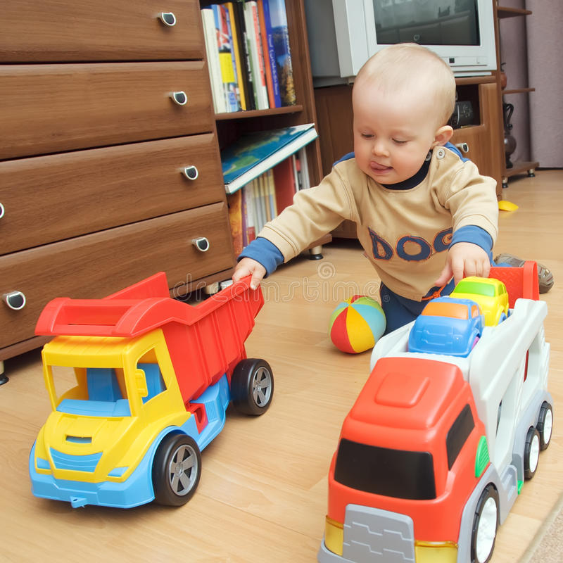 Boy With Two Trucks Royalty Free Stock Photo
