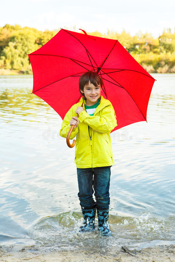Download Boy with umbrella stock photo. Image of joyful, expressive - 27384780
