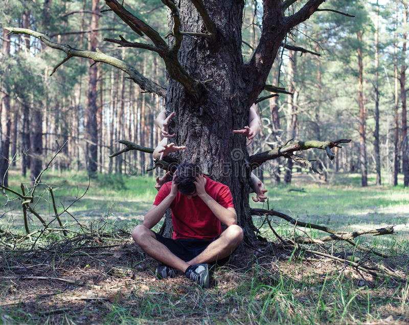 Boy under a tree stock image