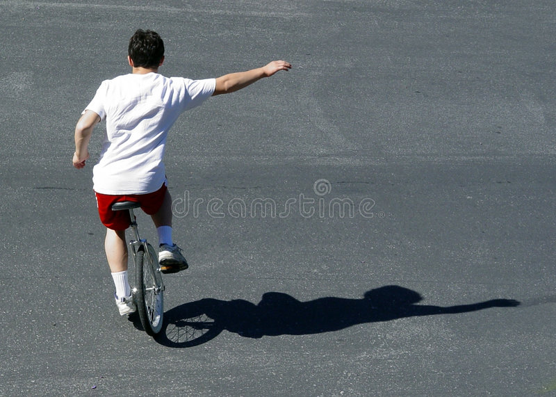 Download Boy on a unicycle stock photo. Image of bike, outdoor, concept - 21106