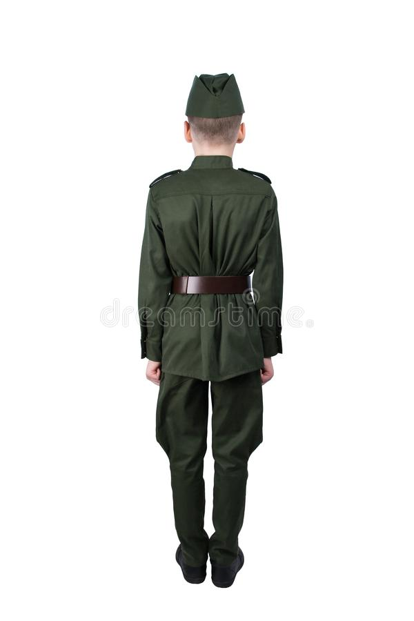 Boy in uniform standing at attention in back view, isolated on white stock image