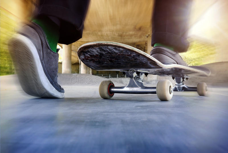 Boy on a used skateboard royalty free stock photography