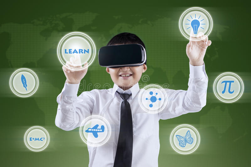 Boy uses VR headset and futuristic screen royalty free stock images